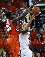 Virginia center Mike Tobey (10) blocks the shot of Clemson center Landry Nnoko (35) during an ACC basketball game Tuesday Jan. 19, 2016, in Charlottesville, Va. Virginia  defeated Clemson  69-62. (Photo/Andrew Shurtleff)