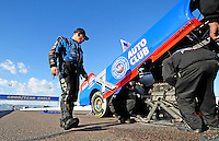 Jan 30, 2008; Chandler, AZ, USA; NHRA funny car driver Robert Hight looks over his car after suffering an incident during testing at the National Time Trials at Firebird International Raceway. Mandatory Credit: Mark J. Rebilas-