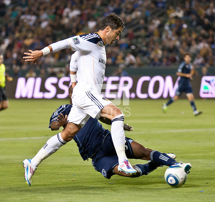 CARSON, CA – May 14, 2011: Sporting KC defender Julio Cesar (55) tackles the ball away from LA Galaxy forward Juan Pablo Angel (9) during the match between LA Galaxy and Sporting Kansas City at the Home Depot Center in Carson, California. Final score LA Galaxy 4, Sporting Kansas City 1.