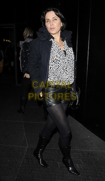 Sadie Frost.The 'Animal Charm' special screening, W hotel Leicester Square, Wardour St., London, England..January 31st, 2012.full length black jacket white leather shorts tights leopard print top boots.CAP/CAN.©Can Nguyen/Capital Pictures.