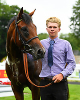 Winner of The Bathwick Tyres EBF Novice Stakes,Beringer ridden by Finley Marsh and trained by Alan King with Lad in the winners enclosure during Ladies Evening Racing at Salisbury Racecourse on 15th July 2017