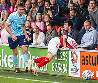 Fleetwood Town's Ashley Hunter is sent sprawling after a battle with Accrington Stanley's Sam Finley<br /> <br /> Photographer Alex Dodd/CameraSport<br /> <br /> The EFL Sky Bet League One - Fleetwood Town v Accrington Stanley - Saturday 15th September 2018  - Highbury Stadium - Fleetwood<br /> <br /> World Copyright &copy; 2018 CameraSport. All rights reserved. 43 Linden Ave. Countesthorpe. Leicester. England. LE8 5PG - Tel: +44 (0) 116 277 4147 - admin@camerasport.com - www.camerasport.com