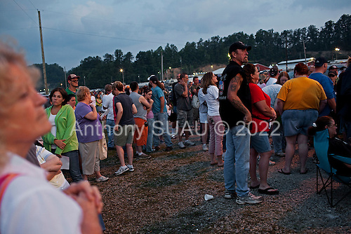 Wise, Virginia.USA.July 25, 2009..People waiting in line at 5.30AM to enter a Remote Area Medical (RAM) health clinic at the Wise County Fairgrounds. The free clinic, which lasts 2-1/2 days, is the largest of its kind in the nation, providing medical, dental and vision services from more than 1,400 medical volunteers.