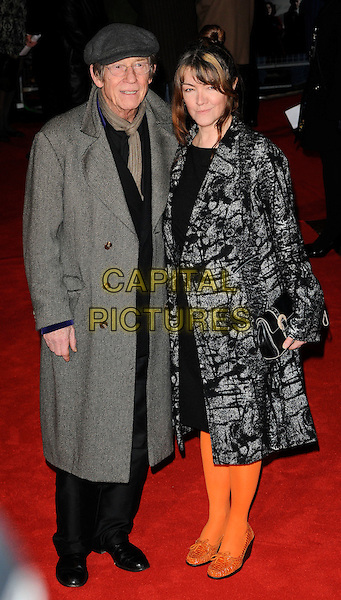 JOHN HURT & ANWEN REES MEYERS.European Premiere of 'Brighton Rock' at the Odeon West End, Leicester Square, London, London, England, UK,.1st February 2011..full length couple married husband wife grey gray coat hat cap orange tights shoes black clutch bag .CAP/CAN.©Can Nguyen/Capital Pictures.
