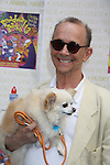 """Joel Grey - Anything Goes attends Broadway Barks Lucky 13th Annual Adopt-a-thon - A """"Pawpular"""" Star-studded dog and cat adopt-a-thon on July 9, 2011 in Shubert Alley, New York City, New York with Bernadette Peters and Mary Tyler Moore as hosts.  (Photo by Sue Coflin/Max Photos)"""