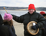 Nick Miles (Pamunkey, Powhatan), wearing red hat, representing the Assn of Native American of the Hudson Valley, seen leading a Native American Water Blessing Ceremony held for the Hudson River at Kingston Point Beach in Kingston, NY, on Saturday, March 4, 2017. Photo by Jim Peppler; Copyright Jim Peppler 2017