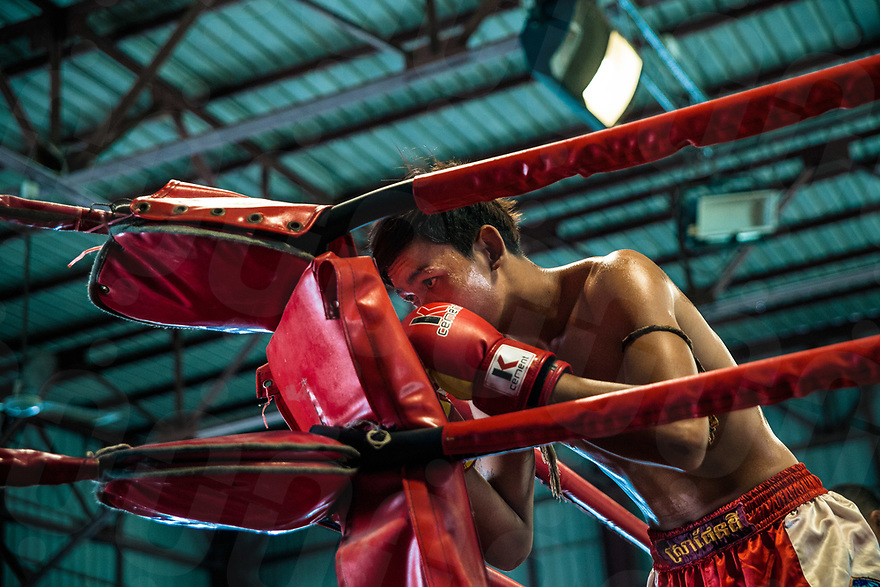 June 30, 2012 - Phnom Penh (Cambodia). Every weekends, CTN studio hosts the matches of Neak Pradals (Cambodian Boxers), the most important sport event for the people of Phnom Penh. Its roots are very ancient, but unlike Muay Thai, this sport hasn't any international recognition. © Thomas Cristofoletti / Ruom
