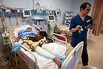 Mcc0030300 . Sunday Telegraph..Ali Senussi, in one of the main hospitals in Benghazi..Ali lost his leg from an exploding Libyan government shell whilst sitting outside his home with 4 of his six brothers in the beseiged town of Ajdabiyah, 150 kms from Benghazi. Two of his brothers lost their lives, the other two are in the same hospital and have also lost limbs...Benghazi 25 March 2011Mcc0030300 . Sunday Telegraph..Ali Senussi being tended to by Anglo/Libyan Dr Omar Bushiha in one of the main hospitals in Benghazi..Ali lost his leg from an exploding Libyan government shell whilst sitting outside his home with 4 of his six brothers in the beseiged town of Ajdabiyah, 150 kms from Benghazi. Two of his brothers lost their lives, the other two are in the same hospital and have also lost limbs...Benghazi 25 March 2011