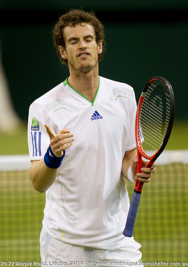 ANDY MURRAY (GBR) (4) against IVAN LJUBICIC (CRO) in the third round of the Gentlemen's Singles. Andy Murray beat Ivan Ljubicic 6-4 4-6 6-1 7-6..Tennis - Grand Slam - Wimbledon - AELTC - London- Day  - Fri June 24th  2011..© AMN Images, Barry House, 20-22 Worple Road, London, SW19 4DH, UK..+44 208 947 0100.www.amnimages.photoshelter.com.www.advantagemedianetwork.com.