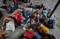 Nepalese immigrants, heading to the southern U.S. border, lie exhausted on the ground in the border checkpoint after crossing the jungle of Darién gap in Panama, 28 January 2015.