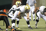 Beverly Hills, CA 09/23/11 - Arthur Fischer (Peninsula #67) and Matt Imwalle (Peninsula #17) in action during the Peninsula-Beverly Hills Varsity football game.