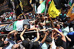 Palestinian mourners carry the body of Hussein Abu Aweida, 41, who died of his wounds endured during clashes with Israeli troops in a tent city protest where Palestinians demand the right to return to their homeland at the Israel-Gaza border, during his funeral in Gaza city, on May 26, 2018. Photo by Mahmoud Ajour