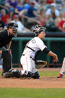 Tri-City ValleyCats catcher Jake Rodriguez (6) throws down to first from his knees during a game against the Lowell Spinners on July 5, 2013 at Joseph L. Bruno Stadium in Troy, New York.  Tri-City defeated Lowell 5-4.  (Mike Janes/Four Seam Images)