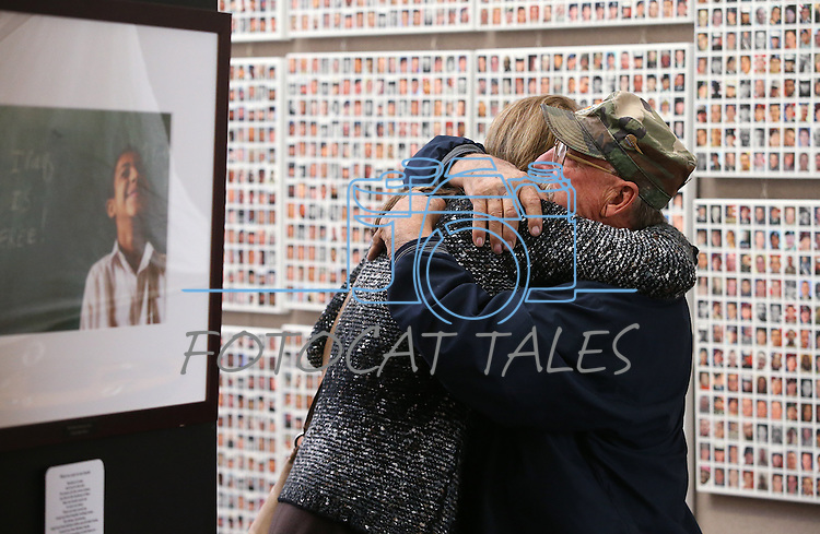 Amy Roby, project manager of the Always Lost: A Meditation on War exhibit, hugs Vietnam Veteran Bruce Bertram at the Legislative Building in Carson City, Nev., on Monday, April 6, 2015. <br /> Photo by Cathleen Allison/Nevada Photo Source