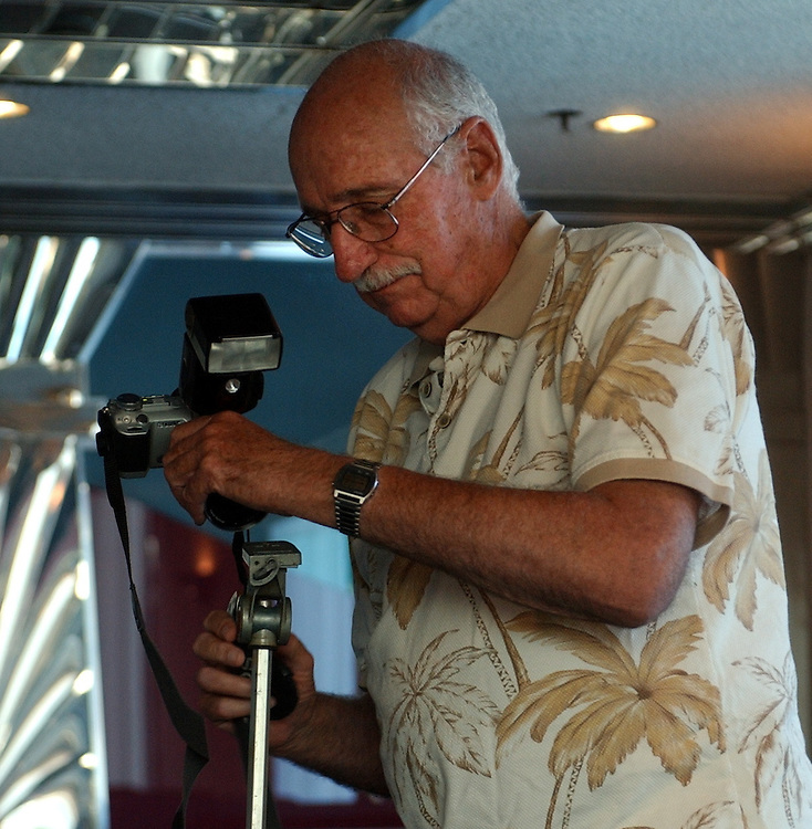 Dick Kraus taking pictures of retires at Dinosaur Brunch at diner in Farmingdale on Monday September 19, 2005. (Newsday Photo / Jim Peppler).