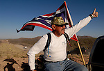 Minuteman Project volunteer Carl Meloche of Wyoming gives a thumbs-up to more Minuteman volunteers as they arrive at the US/Mexico border fence near Naco, Arizona on Monday, April 4, 2005. The Minuteman Project is an all-volunteer group monitoring the US/Mexico border in Arizona for the month of April, reporting all illegal border crossers to the US Border Patrol.<br />