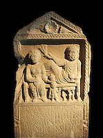 Second century Roman Christian funerary stele for 3 dead people from Africa Proconsularis. The stele depicts the deceased:  Fausata who died age 75, a man who died age 70 and a child who died age 2 years 6 months. From the first half of the second century AD from the region of Bou Arada in present day Tunisia. The Bardo National Museum, Tunis, Tunisia.  Against a black background.