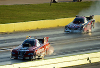 Sept. 21, 2012; Ennis, TX, USA: NHRA funny car driver Cruz Pedregon (near lane) races alongside his tire smoking brother Tony Pedregon during qualifying for the Fall Nationals at the Texas Motorplex. Mandatory Credit: Mark J. Rebilas-