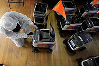 MEDELLÍN, COLOMBIA-APRIL 24: A man disinfects the robots used to deliver food during the new pandemic Coronavirus, COVID-19. on April 24, 2020, in Medellín, Colombia. The launch of Colombian on-demand services Rappi is using robots on wheels designed by KiwiBot as a way to bring food to people who were forced to stay home during childbirth as a preventive measure to stop the spread of COVID-19 (Photo from Fredy Builes / VIEWpress via Getty Images).