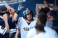 Jarrod Saltalamacchia (39) of the Toledo Mud Hens high fives teammates after hitting a home run against the Louisville Bats at Fifth Third Field on June 16, 2018 in Toledo, Ohio. The Mud Hens defeated the Bats 7-4.  (Brian Westerholt/Four Seam Images)