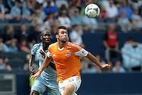 Will Bruin (12) forward Houston Dynamo watches the ball, watched by KC defender Ike Opara..Sporting Kansas City and Houston Dynamo played to a 1-1 tie at Sporting Park, Kansas City, Kansas.