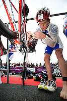 17 SEP 2011 - LA BAULE, FRA - Matt Sharp (Mulhouse Olympique Tri) prepares his bike before the start of the final round of the men's French Grand Prix Series at the Triathlon Audencia in La Baule, France (PHOTO (C) NIGEL FARROW)