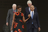 US President Barack Obama (front R), First Lady Michelle Obama (front L), former US President Jimmy Carter (back L) and former US President Bill Clinton (back R) walk down the steps of the Lincoln Memorial to attend the 'Let Freedom Ring' commemoration event, in Washington DC, USA, 28 August 2013. The event was held to commemorate the 50th anniversary of the 28 August 1963 March on Washington led by the late Dr. Martin Luther King Jr., where he famously gave his 'I Have a Dream' speech.<br /> Credit: Michael Reynolds / Pool via CNP