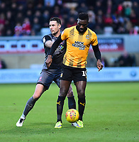 Cambridge United's Jabo Ibehre shields the ball from  Lincoln City's Jason Shackell<br /> <br /> Photographer Andrew Vaughan/CameraSport<br /> <br /> The EFL Sky Bet League Two - Cambridge United v Lincoln City - Saturday 29th December 2018  - Abbey Stadium - Cambridge<br /> <br /> World Copyright © 2018 CameraSport. All rights reserved. 43 Linden Ave. Countesthorpe. Leicester. England. LE8 5PG - Tel: +44 (0) 116 277 4147 - admin@camerasport.com - www.camerasport.com