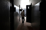 Sco0033837 .  Daily Telegraph..A rebel guard walks through a corridor of empty cells in the Foreign Intelligence Bureau Headquarters in Tripoli...Tripoli 28 August 2011. ............Not Getty.Not Reuters.Not AP.Not Reuters.Not PA