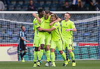 Celebrations as Carl Magnay (centre) of Hartlepool United scores his goal during the Sky Bet League 2 match between Wycombe Wanderers and Hartlepool United at Adams Park, High Wycombe, England on 5 September 2015. Photo by Andy Rowland.