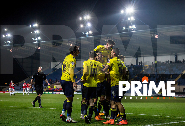Celebrations under the floodlights as Alex MacDonald of Oxford United scorers the 3rd goal during the Sky Bet League 2 match between Oxford United and Dagenham and Redbridge at the Kassam Stadium, Oxford, England on 15 March 2016. Photo by Andy Rowland.