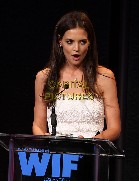 Katie Holmes.2011 Women In Film Crystal + Lucy Awards_Show  Held At The Beverly Hilton Hotel, Beverly Hills, California, USA, 16th June 2011..half length on stage podium speaking strapless white lace show mouth open s initial gold necklace  show.CAP/ADM/KB.©Kevan Brooks/AdMedia/Capital Pictures.