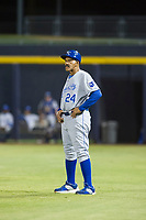 AZL Royals hitting coach Willie Aikens (24) coaches first base during the game against the AZL Mariners on July 29, 2017 at Peoria Stadium in Peoria, Arizona. AZL Royals defeated the AZL Mariners 11-4. (Zachary Lucy/Four Seam Images)