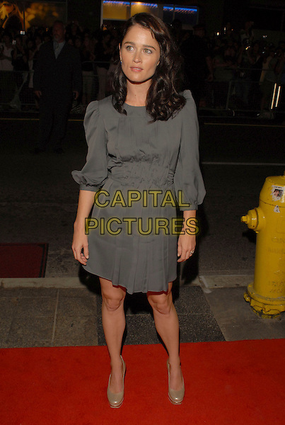 "ROBIN TUNNEY.""The Assassination of Jesse James by the Coward Robert Ford"" Premiere during the 2007 Toronto International Film Festival held at the Elgin Theatre, Toronto, Ontario, Canada, 08 September 2007..full length grey dress gold platfrom shoes.CAP/ADM/BP.©Brent Perniac/AdMedia/Capital Pictures."