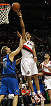 04/03/11--Blazers' Nicolas Batum finger rolls the basket for a basket after being fouled by Mavericks' Dirk Nowitzki in the first half at the Rose Garden in Portland, Or..Photo by Jaime Valdez........................................