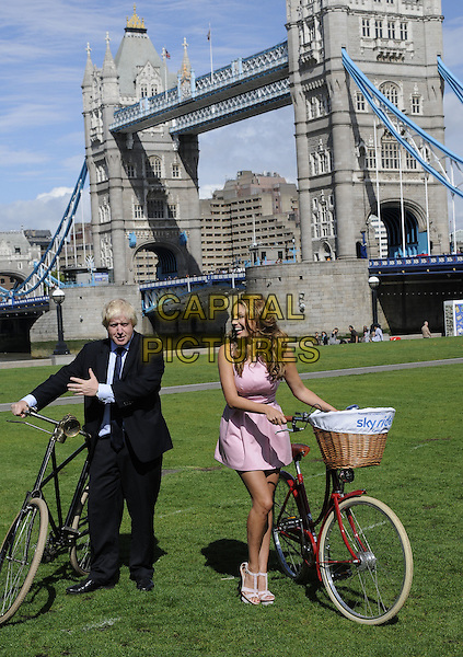 Boris Johnson and Kelly Brook.launch the Mayor of London's Sky Ride.The Queen's  Walk,  London, UK  25th August 201..bicycle, Tower Bridge pink dress full length.CAP/CAN.©Can Nguyen/Capital Pictures.
