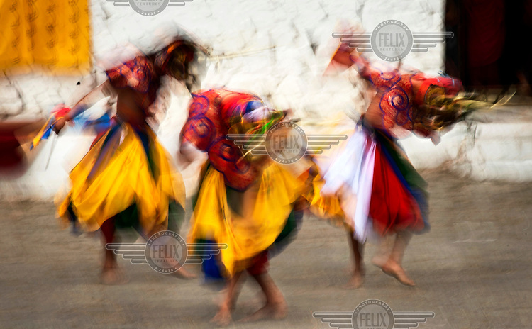 Dancers in costume, perform one of the many ritual dances at the Paro Tsechus Festival.