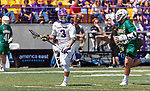 TD Ierlan (#3) carries the ball into the attack after one of his 20 faceoff wins.  UAlbany Lacrosse defeats Vermont 14-4  in the American East Conference Championship game at Casey Stadium, May 5.