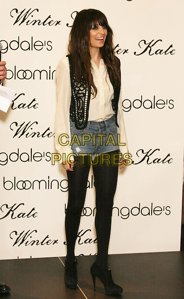 NICOLE RICHIE.Launch her new clothing line, Winter Kate at Bloomingdale's 59th Street, New York, NY, USA..February 16th, 2010.full length black tights jean denim cut off shorts white cream blouse top waistcoat platform ankle boots booties shoes mouth open laughing smiling crochet knit knitted.CAP/LNC/TOM.©TOM/LNC/Capital Pictures.