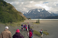 Tourists march across the beach of Lago Grey at Torres del Paine National Park in southern Chile, to reach a cruise boat that will take them to the face of the Grey Glacier. (Kevin Moloney for the New York Times)