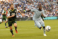 C.J Sapong (17) forward Sporting KC and Mike Chabala (4) defender Portland Timbers chase down the ball... Sporting Kansas City defeated Portland Timbers 3-1 at LIVESTRONG Sporting Park, Kansas City, Kansas.