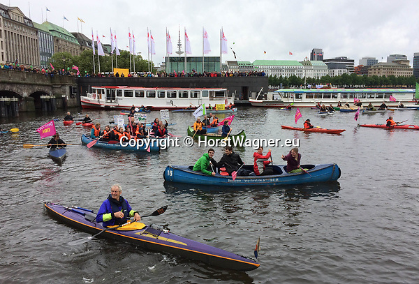 Germany, Hamburg -- July 02, 2017 -- Rally organized by a wide range of NGOs a week prior to the G20-summit in order to urge changes of topics during the meeting; protest-wave in front of the city town hall and on / around lake Binnenalster -- © HorstWagner.eu