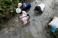 Tran Van Huong is fishing with electric rods nearby Truong Than village, Can Tho province, Mekong delta, Vietnam-2010