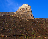 The drunken sway of the chimneystack is an upturned bucket covered in thatch and lime plaster