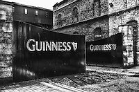 A black and white view of the Guinness Brewery gates in Dublin Ireland.