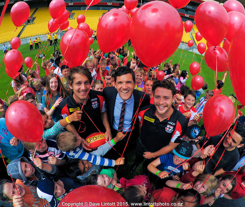 Wellington deputy mayor Justin Lester (centre) with St Kilda AFL players Josh Saunders (centre left) and Jack Steven (right) at the AFL celebration of 100 day countdown until the ANZAC Centenary at Westpac Stadium, Wellington, New Zealand on Wednesday, 15 January 2015. Photo: Dave Lintott / lintottphoto.co.nz
