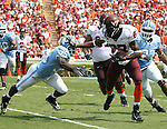 09 September 2006: Virginia Tech's David Clowney (87) stiff arms North Carolina's Bryan Bethea (35). The University of North Carolina Tarheels lost 35-10 to the Virginia Tech Hokies at Kenan Stadium in Chapel Hill, North Carolina in an Atlantic Coast Conference NCAA Division I College Football game.