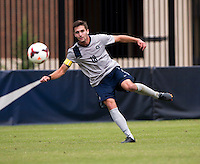 Steve Neumann (18) of Georgetown punts the ball downfield during the game at Shaw Field on the campus of the Georgetown University in Washington, DC.  Georgetown tied Creighton, 0-0, in double overtime.