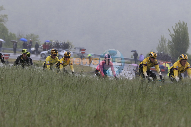 The peloton including race leader Primoz Roglic (SLO) Team Jumbo-Visma wearing the Maglia Rosa climb over the Appenines and into Tuscany during a wet Stage 2 of the 2019 Giro d'Italia, running 205km from Bologna to Fucecchio, Italy. 12th May 2019.<br /> Picture: Eoin Clarke | Cyclefile<br /> <br /> All photos usage must carry mandatory copyright credit (© Cyclefile | Eoin Clarke)