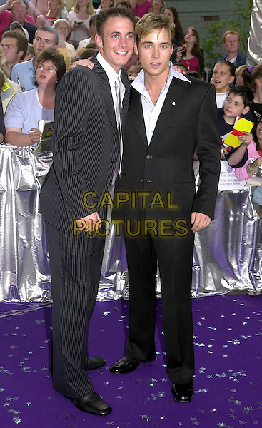 GARY LUCY & MARCUS PATRICK.The British Soap Awards 2001, London, 25th May 2001..full length .Ref: PL.www.capitalpictures.com.sales@capitalpictures.com.©Capital Pictures.